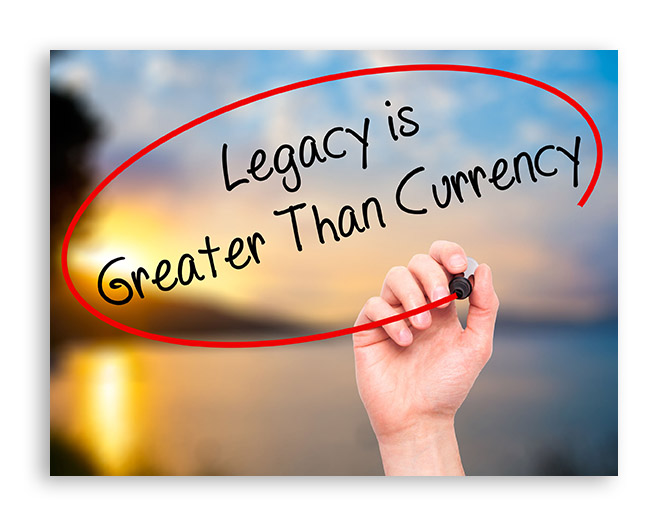 52438010 - man hand writing legacy is greater than currency with black marker on visual screen. isolated on background. business, technology, internet concept. stock photo